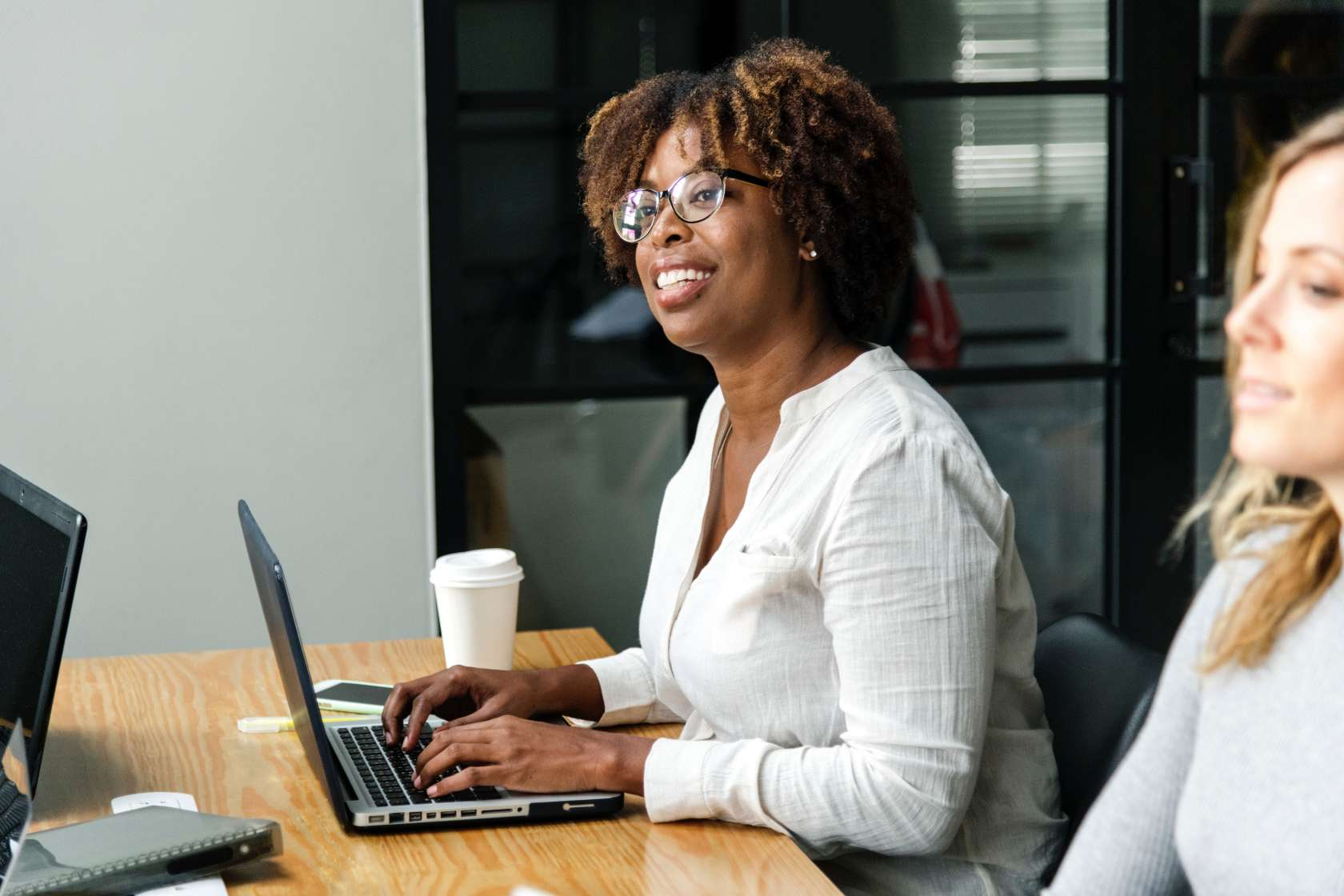 Woman on computer in meeting room