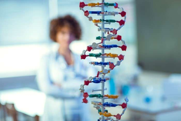 DNA strand in front of woman blurred
